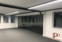 Glazed office partition wall installation